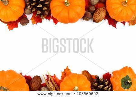 Autumn double border of pumpkins, leaves and nuts over white