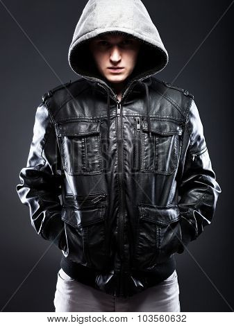 Young Man In Leather Jacket With Hood