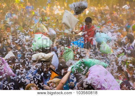 MOSCOW - SEPTEMBER, 27: Young people are fighting pillows at event Big Pillows Battle and Holi paints festival on September 27, 2015 in Moscow