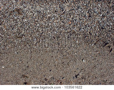 Sand And Small Stones With Fragments Of Shells On The Beach