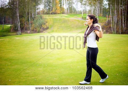 Woman Golf Player Training On Green With Club