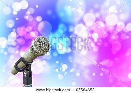 Microphone With Soft Red Green Blue Pink Abstract Background With Beautiful Glitter Twinkling Bokeh.