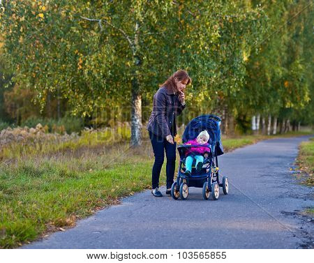 Woman With Little Girl In Stroller