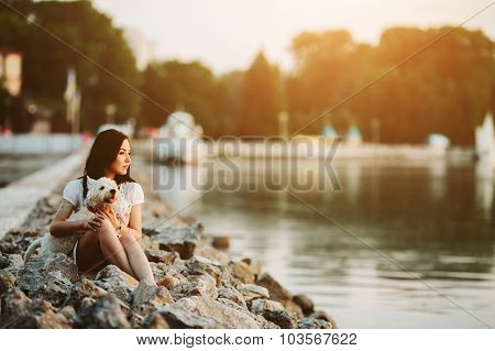 girl with a dog on the promenade