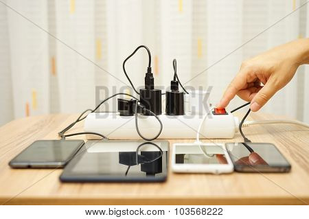 Man Is Turning Off  Power Adapters For Mobile Phones And Tablet Computers