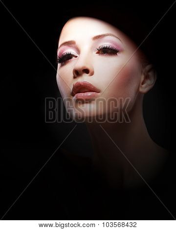 Portrait Of Young Woman Over Black Background