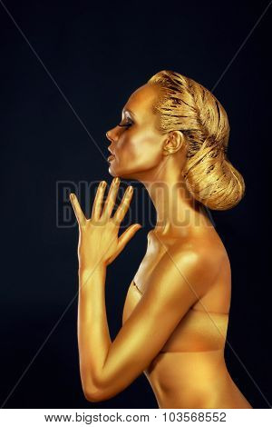 Woman With Golden Body Over Black Background