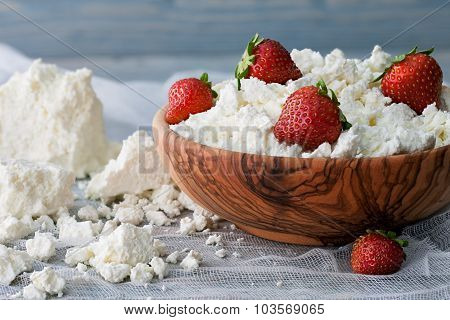 A Bowl With Cottage Cheese And Strawberries