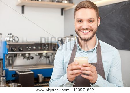 Attractive male owner of coffee shop is working
