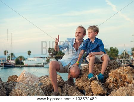 Father With Son In Tropical Sea Harbor On Sunset Time