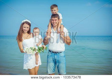 Family Having Fun On The Beach