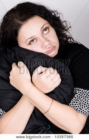 Pretty Woman Holding A Pillow