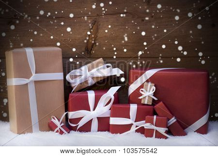 Red Christmas Gifts And Presents With White Ribbon, Snowflakes