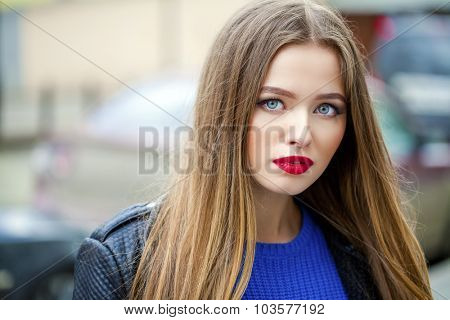 Portrait close up of young beautiful haired woman, on spring street background