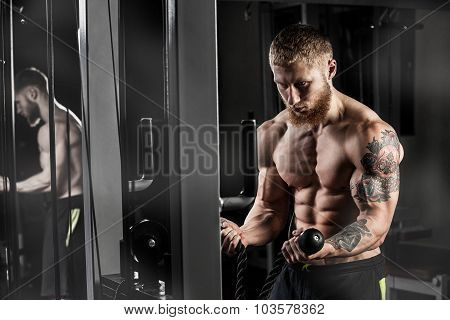 Athlete Muscular Bodybuilder In The Gym Training With Bar