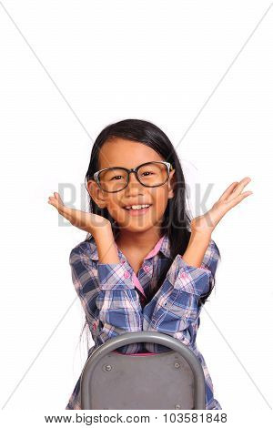 Little Girl Smiling And Showing Hurray Gesture