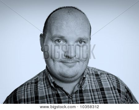 Close Up Smiling Portrait Capture Of Overweight Male