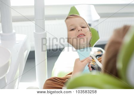 Cute small male child is visiting dental doctor