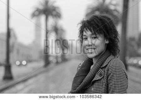 Outdoor photo of young african american woman walking in San Francisco