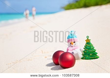 Snowman On The Sandy Sea Beach. Holiday Christmas Concept Horizontal Composition