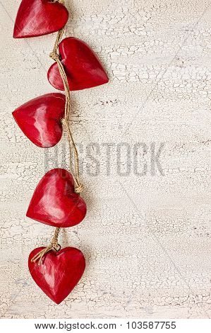 Red Wooden Hearts On Old White Wooden Background