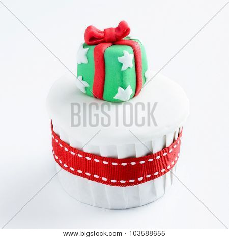 Christmas cupcake in traditional red green colours with present gift box decorative element