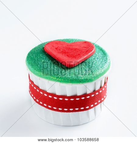 Christmas cupcake in traditional red green colours with heart decorative element