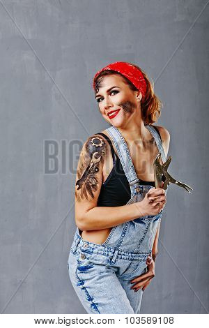 Girl Mechanic Holding A Hand Vise.