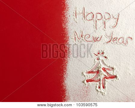 Happy New Year written on white snow. Christmas card.