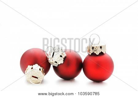 Red christmas baubles in a row, xmas decoration with ribbon isolated on white