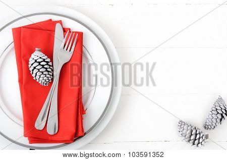 Christmas table setting in red and white, modern simple design with white pine cone as xmas element