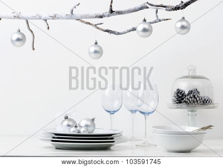 Christmas decoration table display in silver frosty icy tone, simple minimalist elegant design