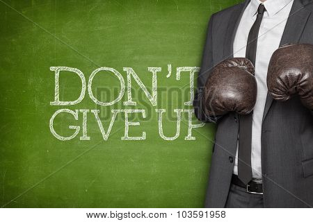 Dont give up on blackboard with businessman on side