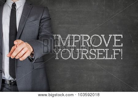 Improve yourself on blackboard with businessman