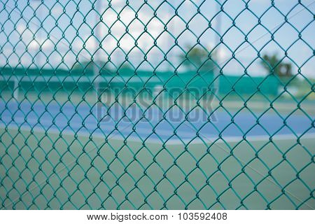 Cage Of Blurred Tennis Court