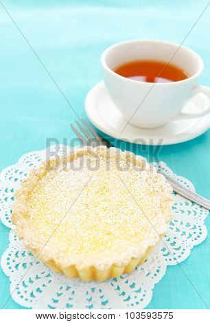 Appetising dessert of lemon tart and a cup of tea