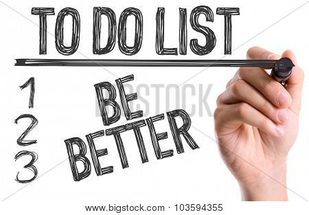 Hand with marker writing: To Do List: Be Better