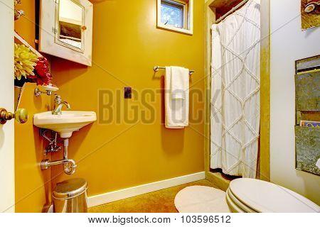 Bright Yellow Interior Of Vintage Style Bathroom.