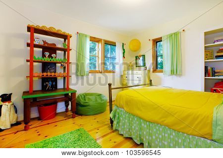 Colorful Interior Of Kidsbedroom With Yellow Bedding.