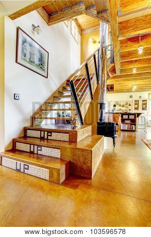 Interior Of Artsy Home With Brilliant Staircase.
