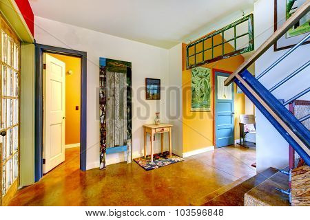 Unique Entryway To Home With Very Colorful Interior.