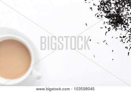 Hot milky tea with tea leaves, overhead view with plenty of copy space