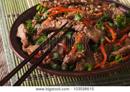 Slices Of Beef Fried With Sesame Seeds And Carrots Closeup. Horizontal