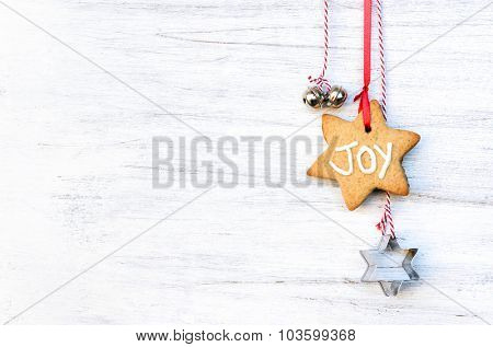 Christmas background with gingerbread decorations, silver bells and star cookie cutters, plenty of copy space