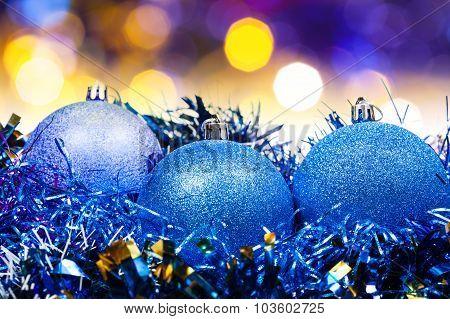 Xmas Blue Balls On Blurred Violet Background