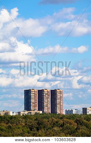 Blue Sky With White Clouds Over Apartment Building