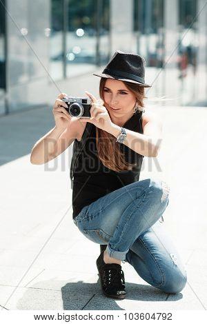 Stylish Girl  Photographs With The Digital Camera.