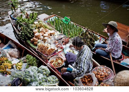 RATCHABURI THAILAND - AUGUST 28: Food boats at Damnoen Saduak floating market on August 28 2010 in R