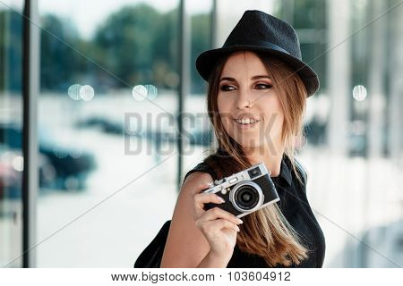 The Girl With The Mirrorless Digital Camera.