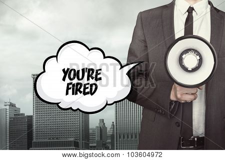 Youre fired text on speech bubble with businessman and megaphone